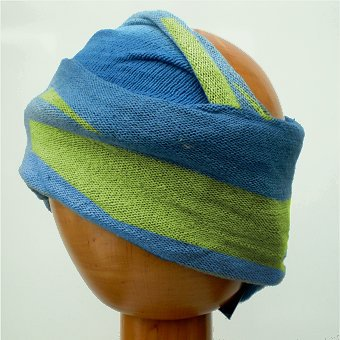 A Fair Trade Tie Dye Stretch Cotton Headwrap/Dreadwrap in Blue and Green colours shown on wodden mannequin head