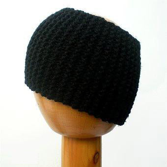 Dreadz Chunky Knitted Head Band / Tube (Black) displayed on wooden mannequin's head against white background