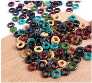 Picture of dozens of Wooden Earth Tones Hoop 6mm Hole Dreadlock Hair Beads displayed on wooden surface
