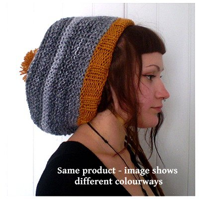 side view of Dreadz Hand Knitted Slouchy Ribbed Brim Beanie Bobble Hat AW range, worn by female model with dreads tucked in to hat