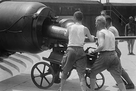 Artillery Men in Training Load Big Gun with Massive Shell