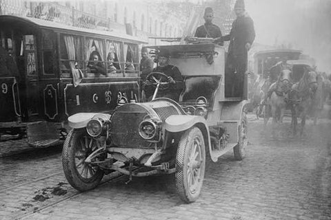 Armored Automobile juxtaposed with Trolley Car & Horse Team on a City Street in Turkey