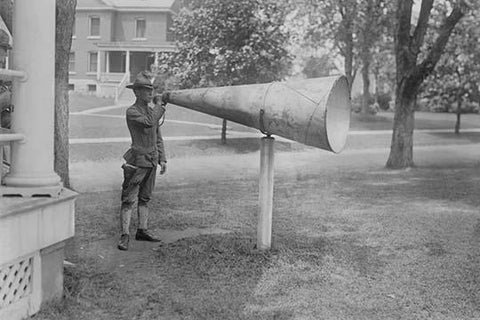 Soldier Plays his bugle into a huge megaphone at Fort Totten, Bayside Queens New York