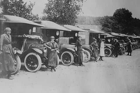 A line of Women Ambulance Drivers with their vehicles