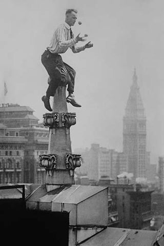 Reynolds Juggles balls on the Pinnacle of a roof high above New York City