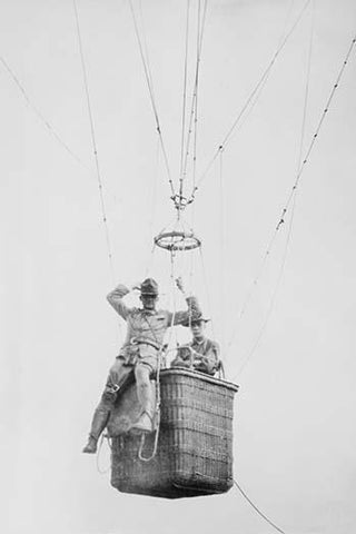 Balloon jump by a parachutist hanging from a basket suspended by it but out of the image.