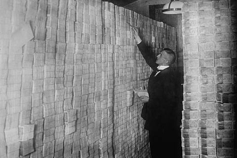 Inflation in Weimar Germany has paper money stacked from Floor to Ceiling in a Berlin Bank