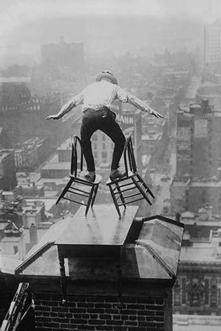 Reynolds performs a balancing act on roof in New York City
