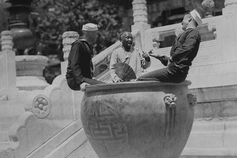 U.S. Navy Sailors on Shore Leave in Beijing frolic in Giant Ceramic Pot with Guide
