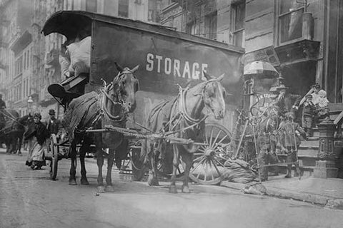 Horse Drawn Wagon with sign saying STORAGE unload the home content of a family being evicted