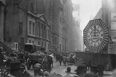 Wagons trundle along Manhattan Streets past a YMCA clock sign