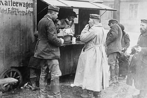 Husband & Wife Coffee Vendor serves German Soldiers