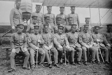 Graduating Class of Japanese Aviators in Uniform with Ceremonial Swords seated in front of Airplane
