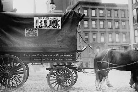 Horse & Wagon with sign saying that it is being used in Interstate Commerce Only
