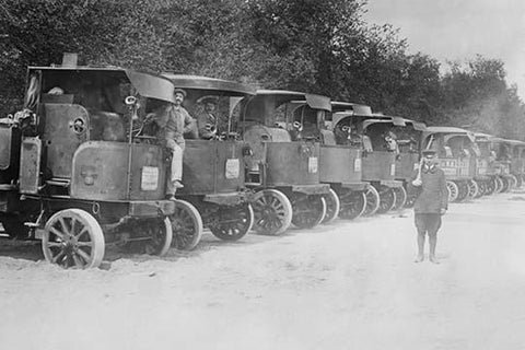 A Fleet of Trucks each with its own Driver is arrayed and ready to transport troops.