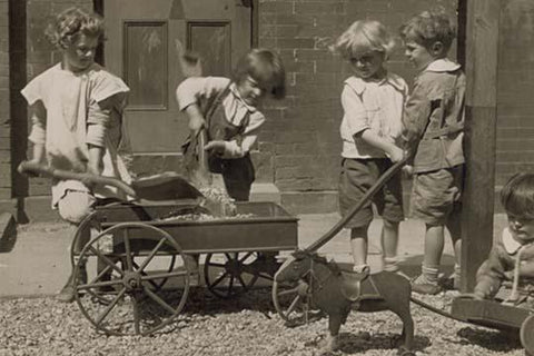 Children Load stones in Wagon with Shovel