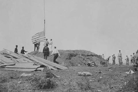 Hoisting the flag at Guantanamo, June 12, 1898