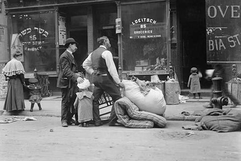 Outside of a Jewish Butcher Shop, Evictees look over their possessions