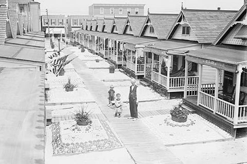 Porches and front lawns of row of bungalows, Rockaway, N.Y.