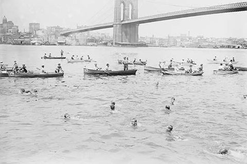 Swimmers Race to Coney Island just past the Brooklyn Bridge