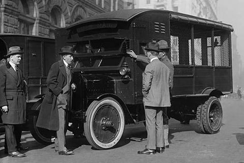 Delivery of New Mail Truck Inspected by four men