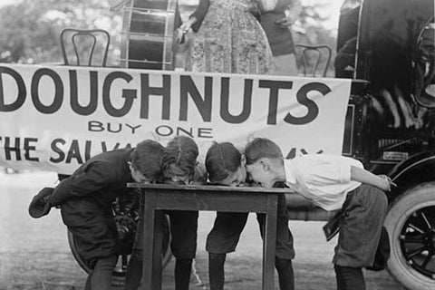 Boys Chow Down on a Table in a Donut Eating Contest
