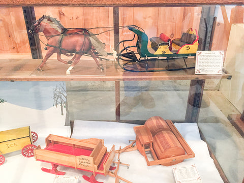 Triple Mountain Breyer sleighs and winter vehicles in the model horse and carriage exhibit at Skyline Farm