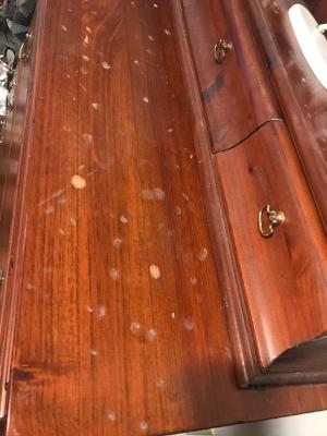 Dresser with lacquer finish damage from model horses