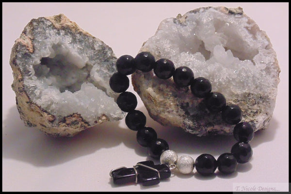 Astraios - Faceted Black Onyx Cross Bracelet