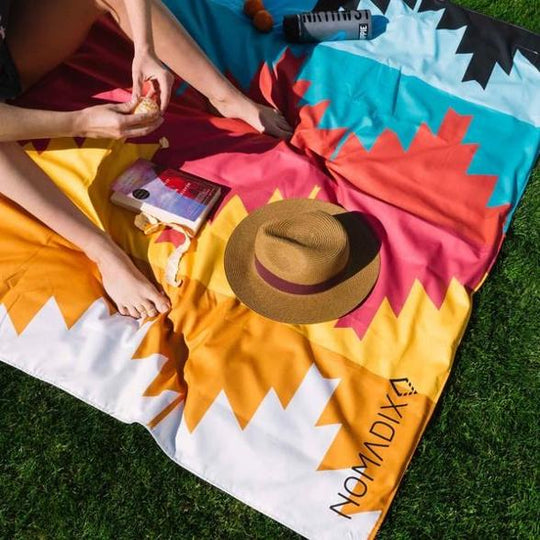 Nomadix Festival Blanket with person reading and hat