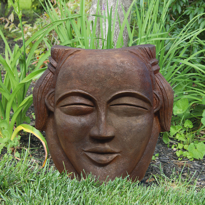 Asian Face Statue