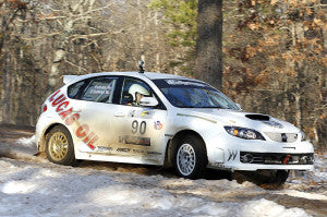 Subaru Rally car slides around corner at 100AW Rally