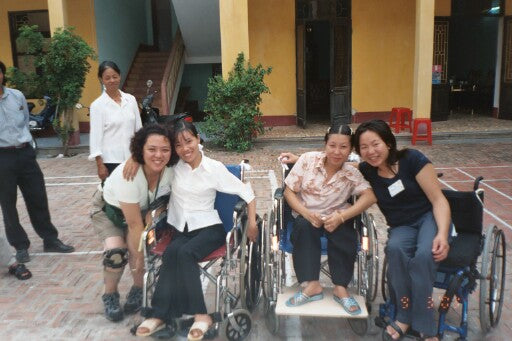 Diane with her two new friends in Vietnam, 2003.