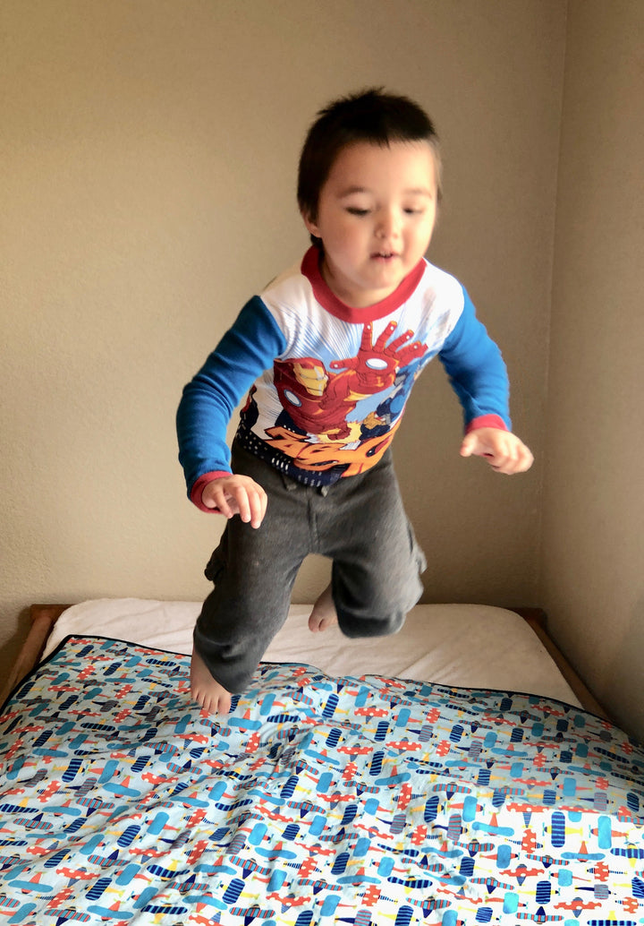Organic Cotton colorful airplanes make this pee pad a playful (and lasting) way to give your kids a dry night's sleep (and moms a lot less laundry).