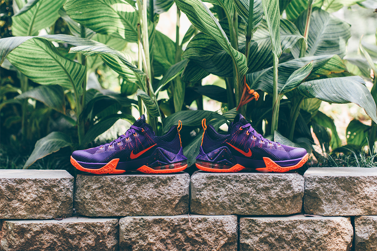 the best attitude c85eb c7155 This low-top version of the Nike LeBron 12 is dressed in a Court Purple,  Bright Crimson, Cave Purple, and Laser Orange color scheme.