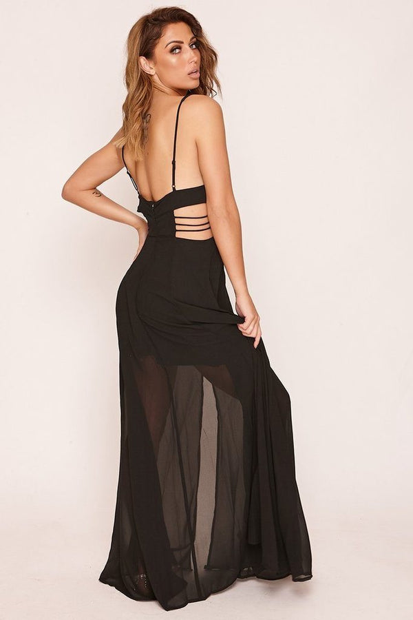 woman in black cut out sides maxi dress