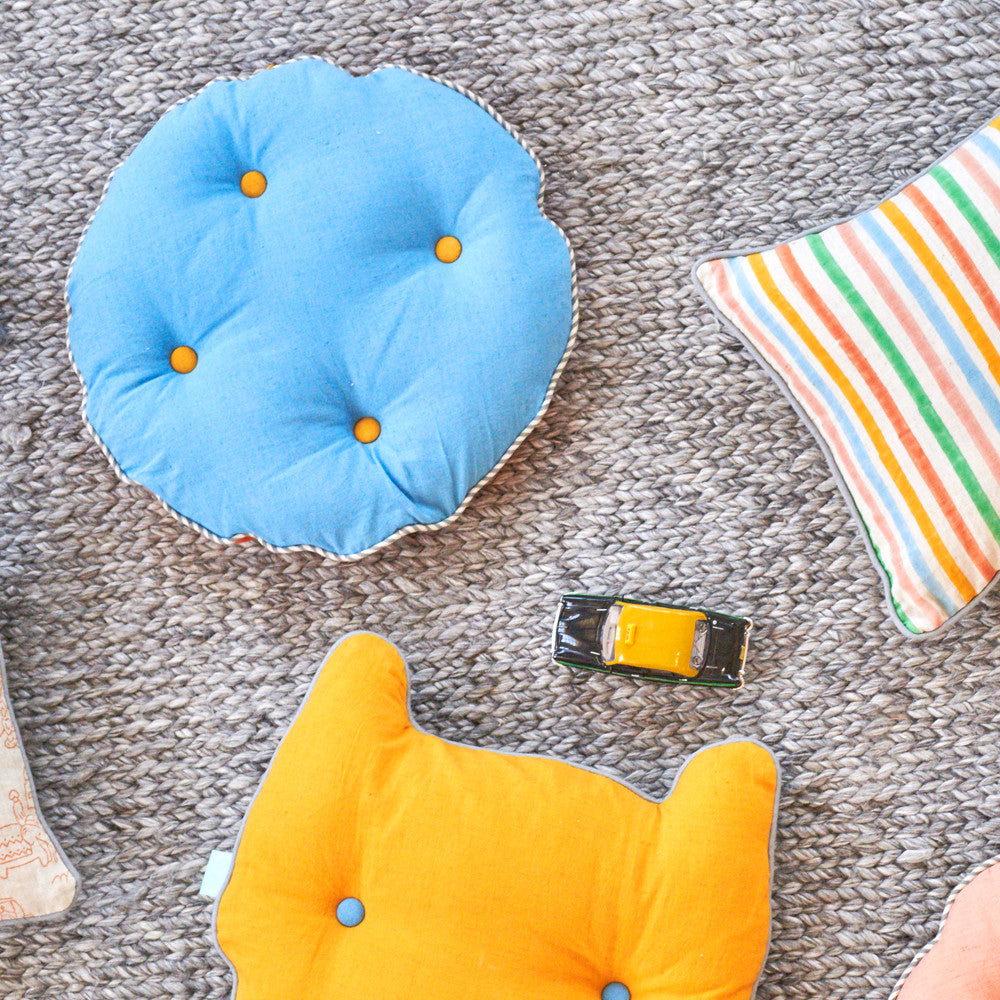 circle button cushion - sky