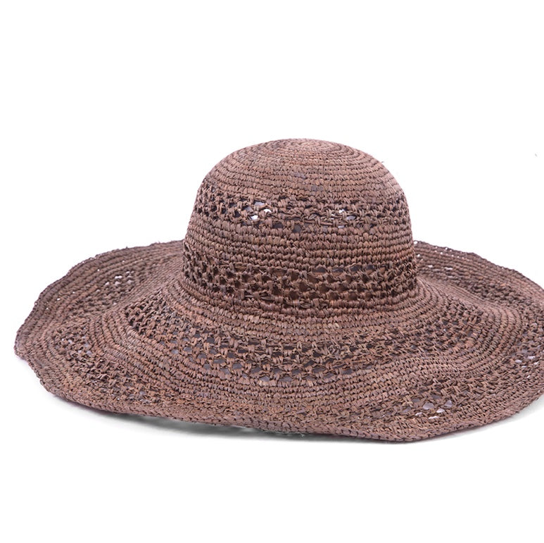 Brown floppy woven hat