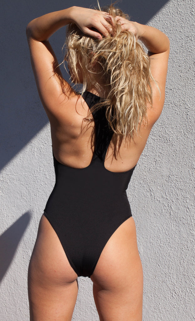 Sleek black zip up one piece