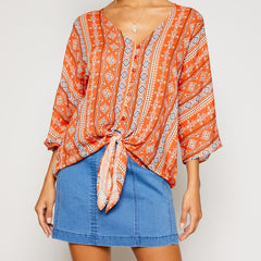 Rhodes Coral Tie Blouse from Sadie & Sage at Charm Boutique in Gulf Shores, Alabama