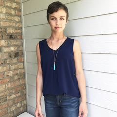 Navy V-Neck Sleeveless Top by Skies are Blue at Charm Boutique