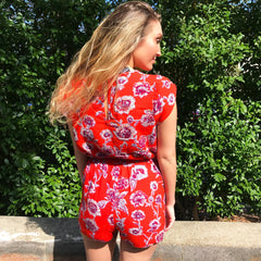 Red Floral Romper by Angie at Charm Boutique in Gulf Shores