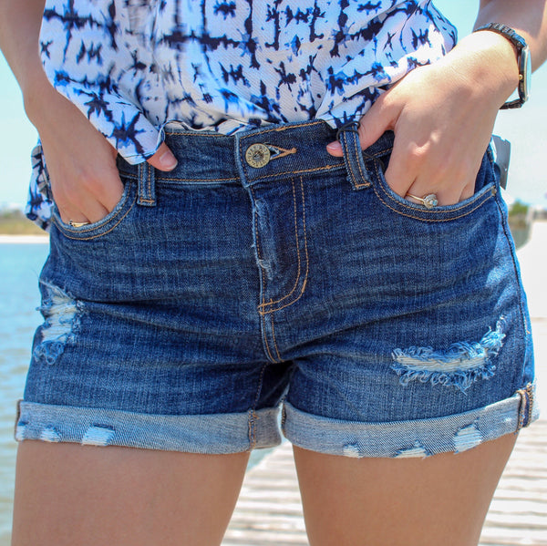 Mid Rise Distressed Cutoff Shorts by Sneak Peek at Charm Boutique in Gulf Shores, Alabama