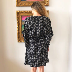 Black Poncho Dress by Angie at Charm Boutique in Gulf Shores