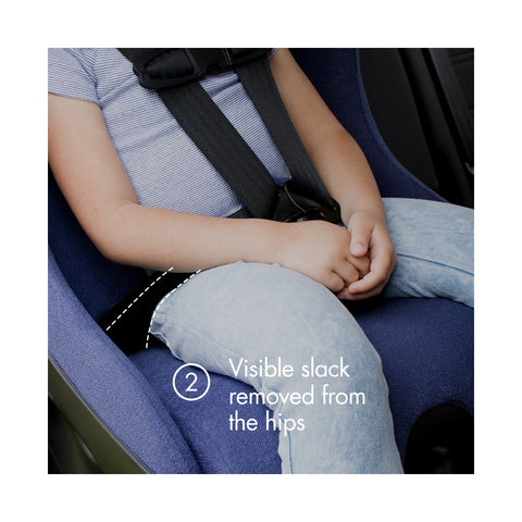 "Young child forward-facing in a purple Clek car seat with text ""visible slack removed from the hips"""