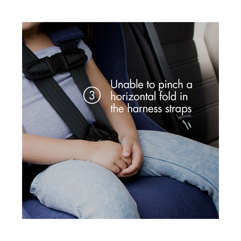 "Young child forward-facing in a purple Clek car seat with text ""unable to pinch a horizontal fold in the harness straps"""
