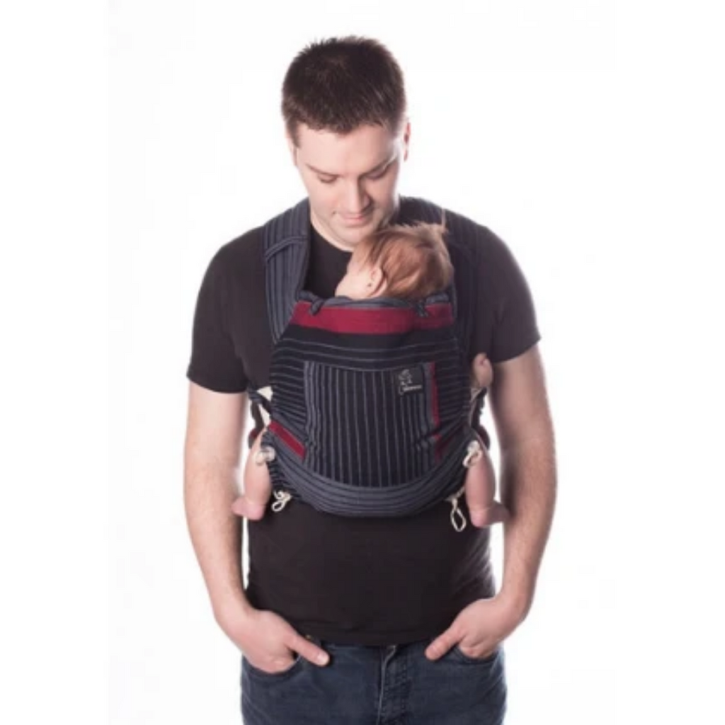 adult with short hair carrying young baby in a Chimparoo Meh Dai