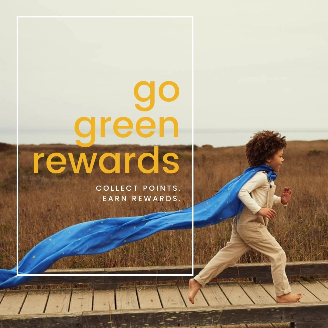 """child running barefoot on a boardwalk in front of a grassy landscape, wearing a Sarah's Silk Giant silk tied as a cape. Text on the graphic says """"Go Green Rewards collect points, earn rewards"""""""