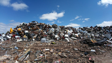 Large pile of waste sits in a landfill