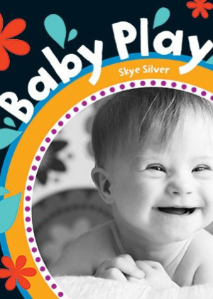 front cover of Baby Play board book by Skye Silver showing a photo of smiling baby in black and white